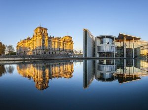 Reichstag with reflection in river Spree, Berlin