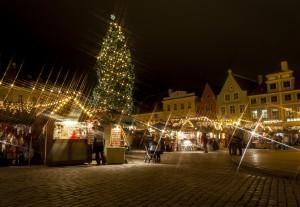 Christmas market around fir tree in Tallinn, Estonia